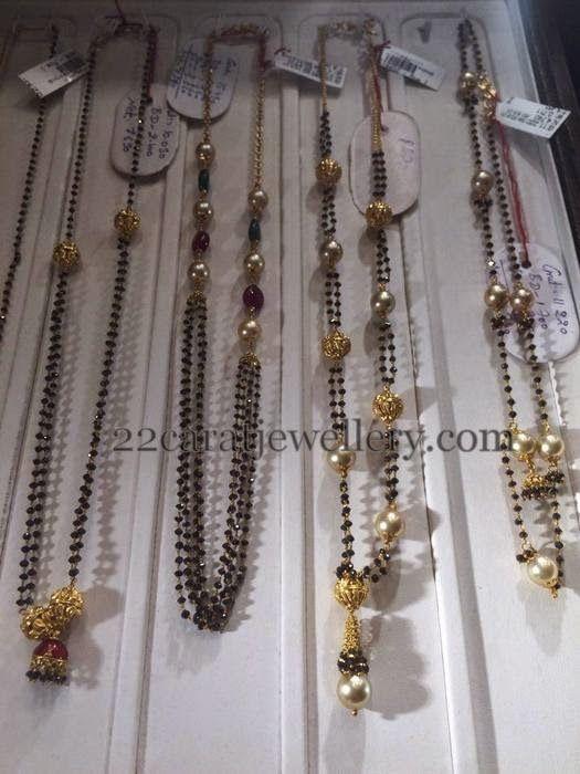 Jewellery Designs: Black Beads Sets with Jhumka Lockets