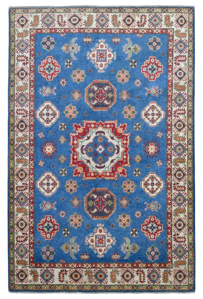 Design Kazak Size 6'1X9' Shades Of Color Included Blue, Beige - Multi-Colored Knot Technique 100% Hand Knotted Rug Foundation Cotton Pile 100% Fine Wool Retail Price $6,000 - $6,500 Condition New: Nev