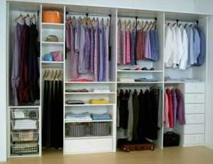 White Reach-in. Good use of space. Most people have short items, medium length items, and long hang items. The long hang items are generally the most narrow section of your closet. I'm not sure why they split the long hang items in this design, but it works well, and looks cute.