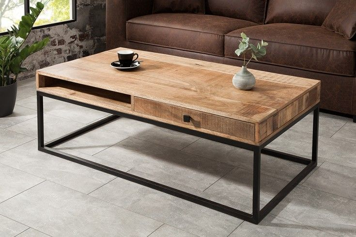 The mango wood coffee table with two drawers perfectly suits the popular ind …