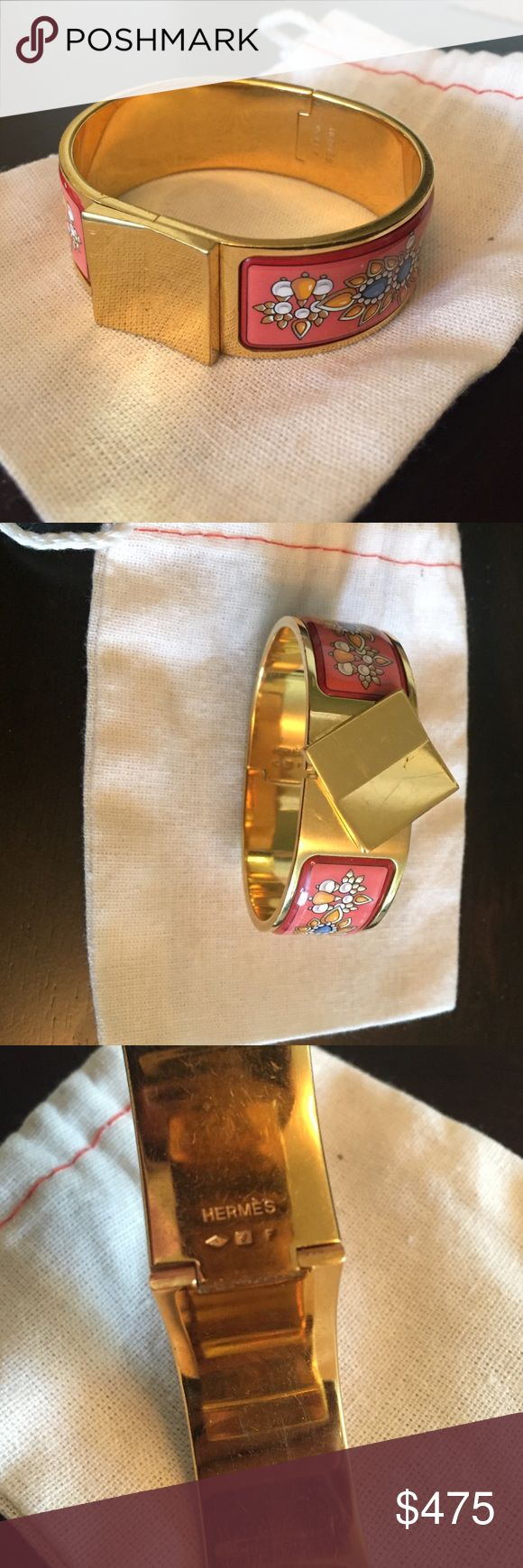 Hermes Wide Loquet Enamel Bracelet (GM) Gold-tone Hermes Wide Enamel Loquet Bracelet with coral floral motif print inlay and slide lock closure. Stamped F from 2002. Includes dustbag. In excellent pre-owned condition, minor scratches - 9/10. Hermes Jewelry Bracelets