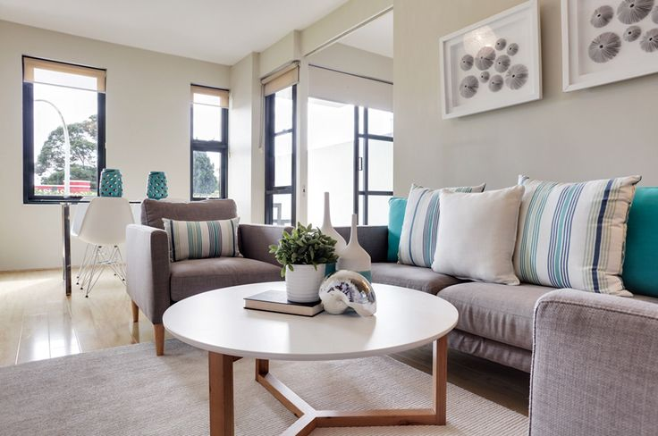 Teals and whites brighten this coastal property!