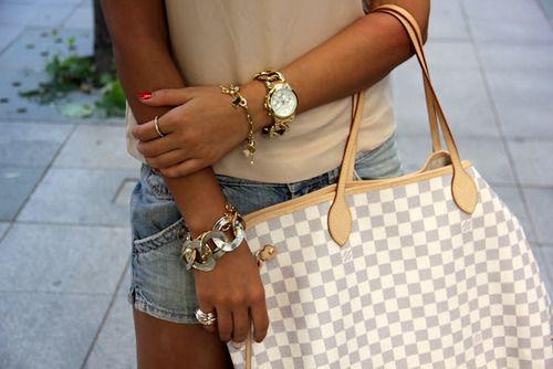 Louis Vuitton totes.