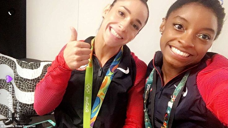 Happy with their haul! Biles and Raisman pose on Snapchat after their exceptional efforts...