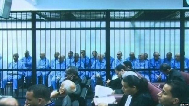 A court in Libya has sentenced Saif al-Islam Gaddafi,the remaining  son of murdered leader Col Muammar Gaddafi, and eight others to death over war crimes linked to the 2011 revolution. More than 30 close associates of Col Gaddafi were tried for suppressing peaceful protests during the uprising. Saif al-Islam was not in court, but has previously appeared via video link.He is being held by a former rebel group from the town of Zintan that refuses to hand him over