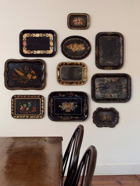 gallery wall of black trays: Remodelista