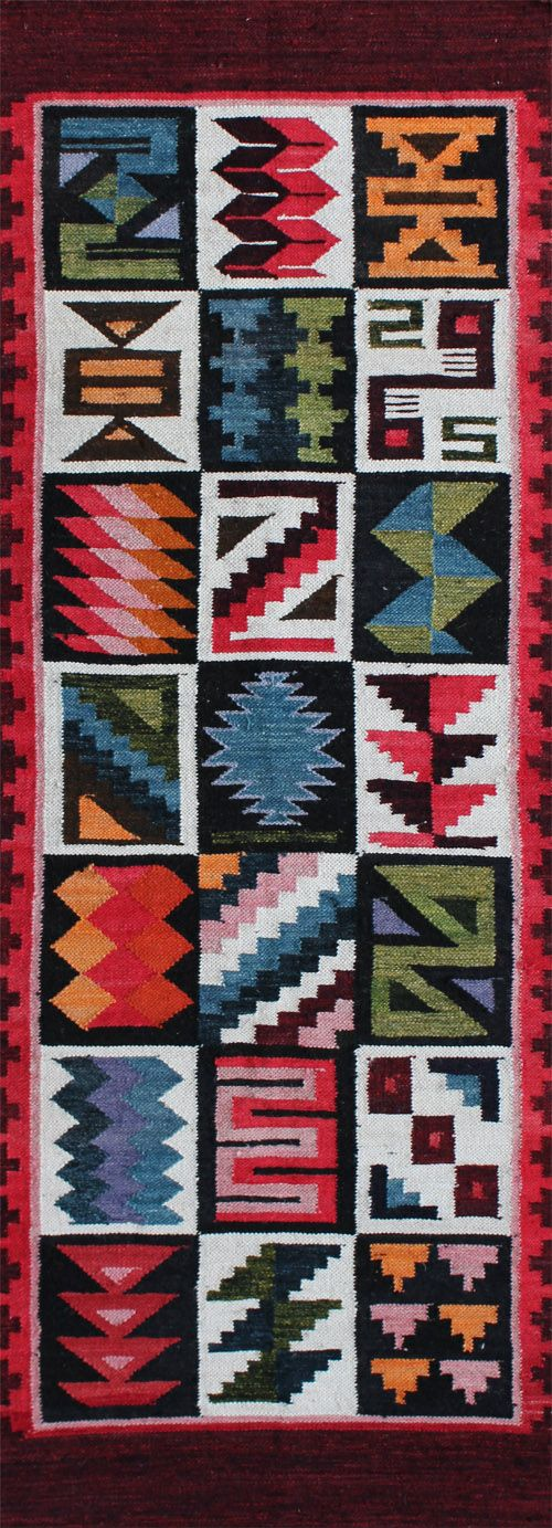 "rug #: 2-105 type: Peruvian Weaving origin: Peru size: 1'11"" x 5'1"" This geometric rendering of a traditional Inca calendar design is beautifully executed with a well balanced choice of deep and saturated colors on a warm ground."