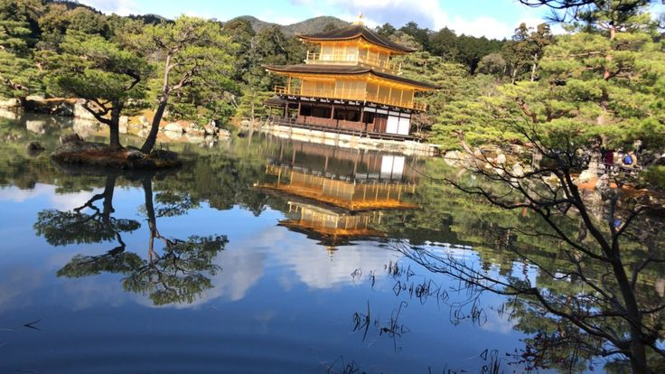 Kinkakuji is a Zen temple covered in gold leaf found in the north of Kyoto. It is famous for its multi architectural design and beautiful reflection before a large pond.