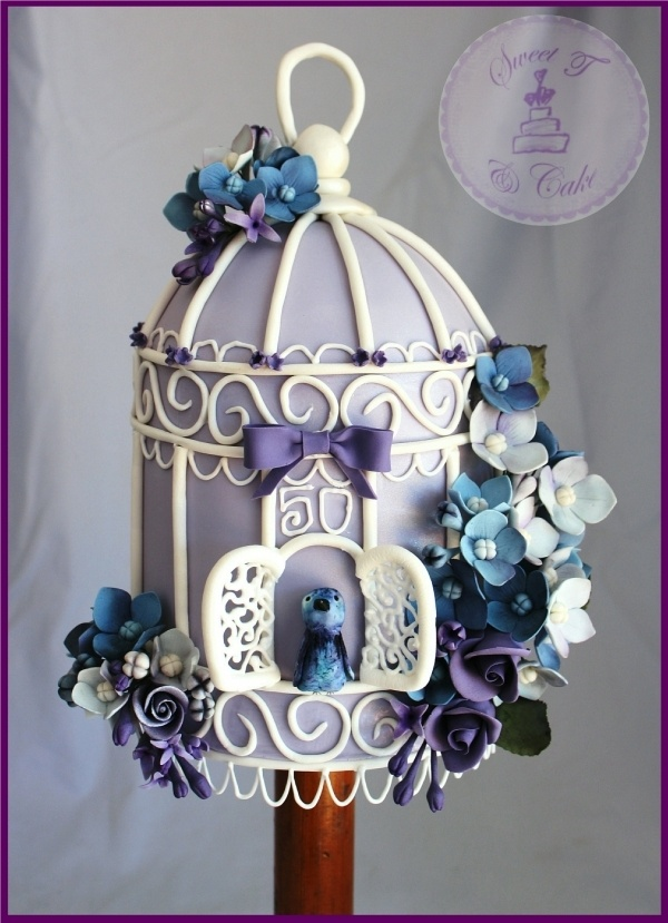 This is the most stunning birdcage cake I've come across.  love the colours, the lacework, the intricacy of the flowers and the bird.   ♥