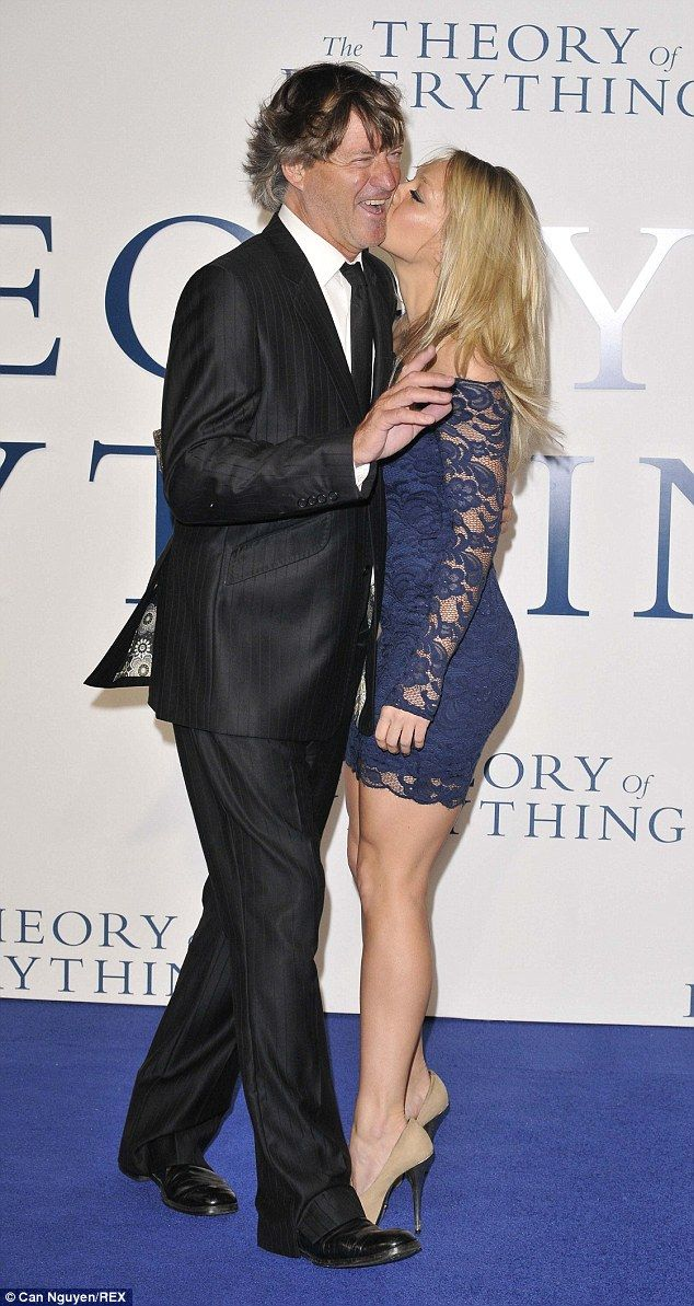Pucker up: Chloe Madeley plants a kiss on her TV presenter father Richard on the red carpe...