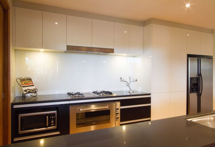 Modern kitchen with no handles. Gloss and textured finishes used. www.thekitchendesigncentre.com.au