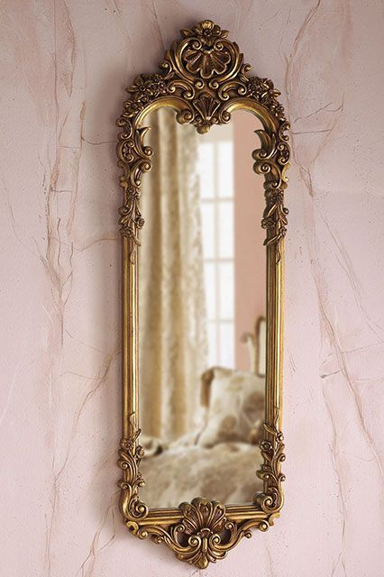 This gold mirror is a space-saving version of Bonnet's triptych. #refinery29 http://www.refinery29.com/audrey-hepburn-inspired-decor#slide-23