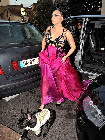 The singer turns heads in a daring dress as she steps out with French bulldog Asia in Suresnes, France, on Saturday. http://www.peoplepets.com/people/pets/gallery/0,,20869551,00.html#30245144
