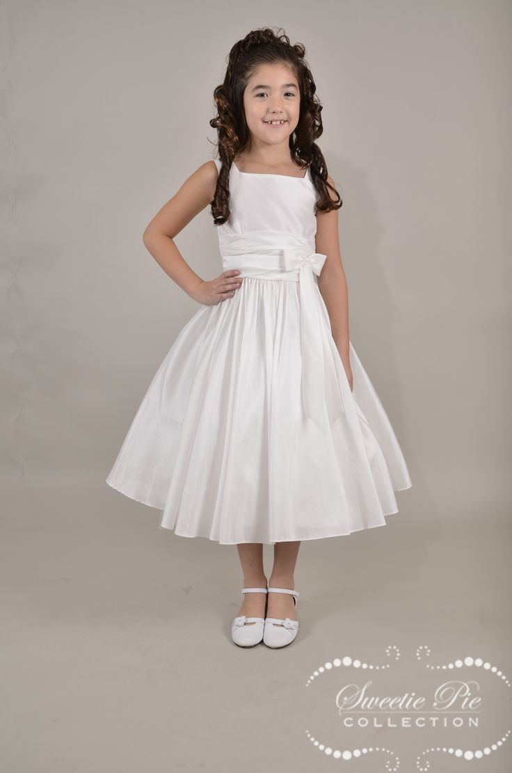 Taffeta Flower Girl Dress 385 by Sweetie Pie has a taffeta bodice and full skirt. Taffeta Flower Girl Dress features pleating on lower bodice with a beautiful taffeta sash at waistline.  Sash has a small bow next to left seam.  This is a simple yet elegant dress for any special occasion. You can view this beautiful flower girl dress at; http://www.sweetiepiecollection.com/product/taffeta-flower-girl-dress-385/ and purchase it through us at BB Gowns.