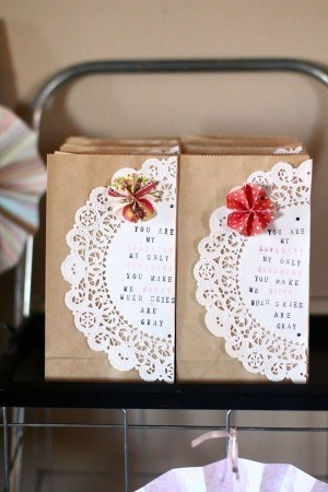 Hand stamp onto paper doilies and use as toppers for your gift wrap.