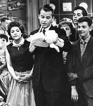 """Dick Clark on the """"American Bandstand"""" TV show - a list of notable guest artists that performed on the show"""