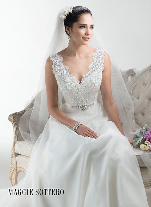 Flowing organza gives this A-line wedding dress an ethereal look, with glittering Swarovski crystal grosgrain ribbon belt and scalloped lace neckline.