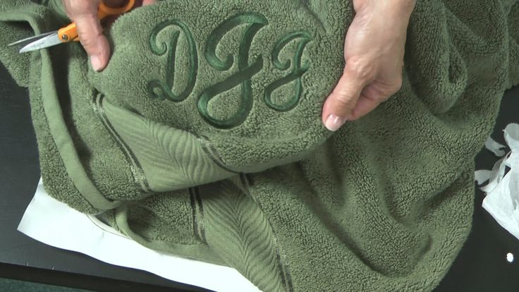 Video tip- how to hoop towels without pulled loops; 1st: iron fusible stabilizer to back of towel, 2nd: hoop using tear away sticky paper--the fusible paper is easier to remove and works as a buffer