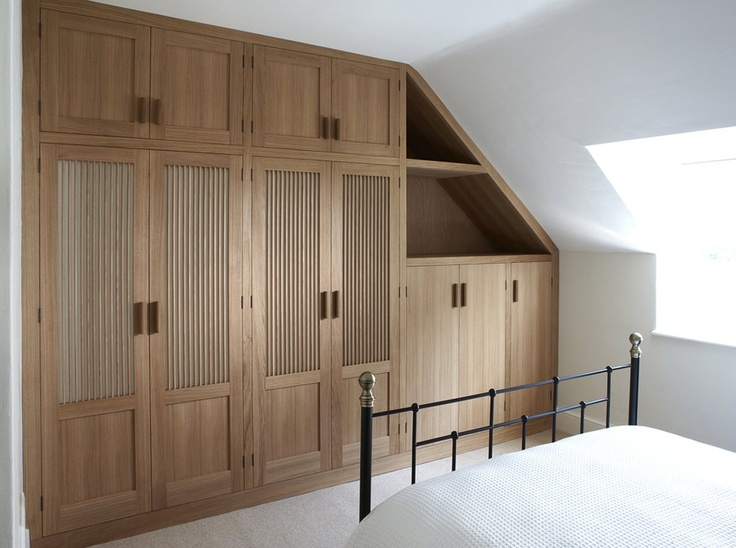 Fitted Wardrobes In Oak, Finished In Danish White Oil. Faux Ostrich Skin  Panels Mounted Behind Slender Vertical Slats Complement The Neutral Decor  Of An ...