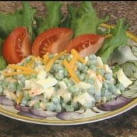 Green Pea and Cheese Salad, one of my sisters favorite salads, Mom always added chopped onion and no pickles.