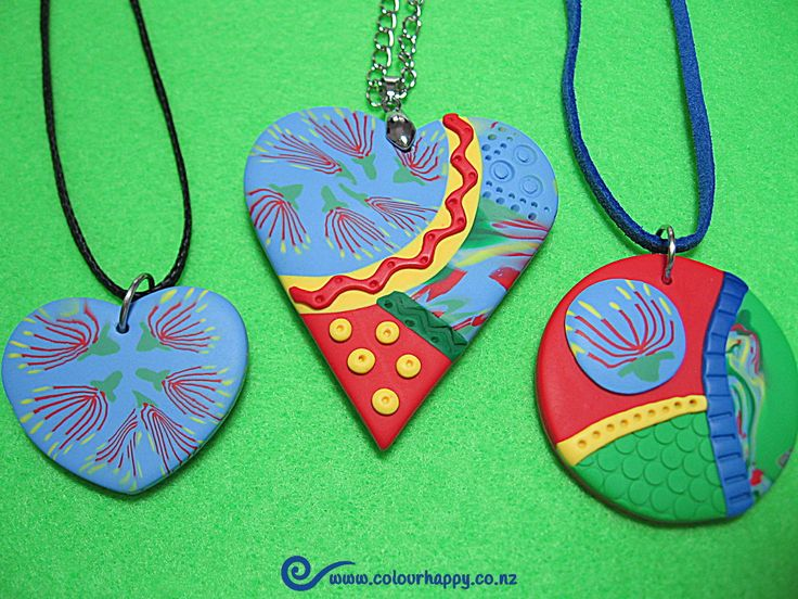 I call this series 'Pohutukawa and Blue Sky'. In New Zealand Christmas falls in summer and the Pohutukawa trees are in full bloom. We think of them as our very own native Christmas trees, left to grow outside and be enjoyed by all. Pendants by Colour Happy / Adele