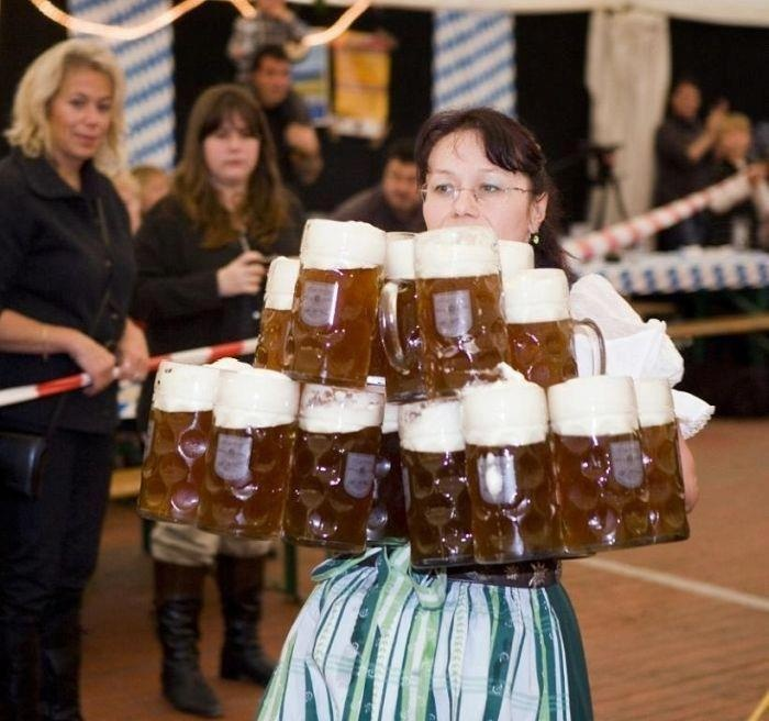 Impressive! October fest in Germany, I've seen women carry beer steins like this!