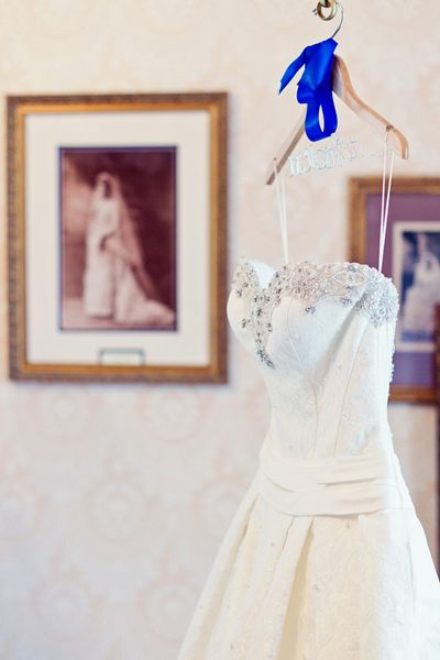 Take a photo of your dress with a picture of your mom in her wedding gown in the background.   Vanessa Joy Photography