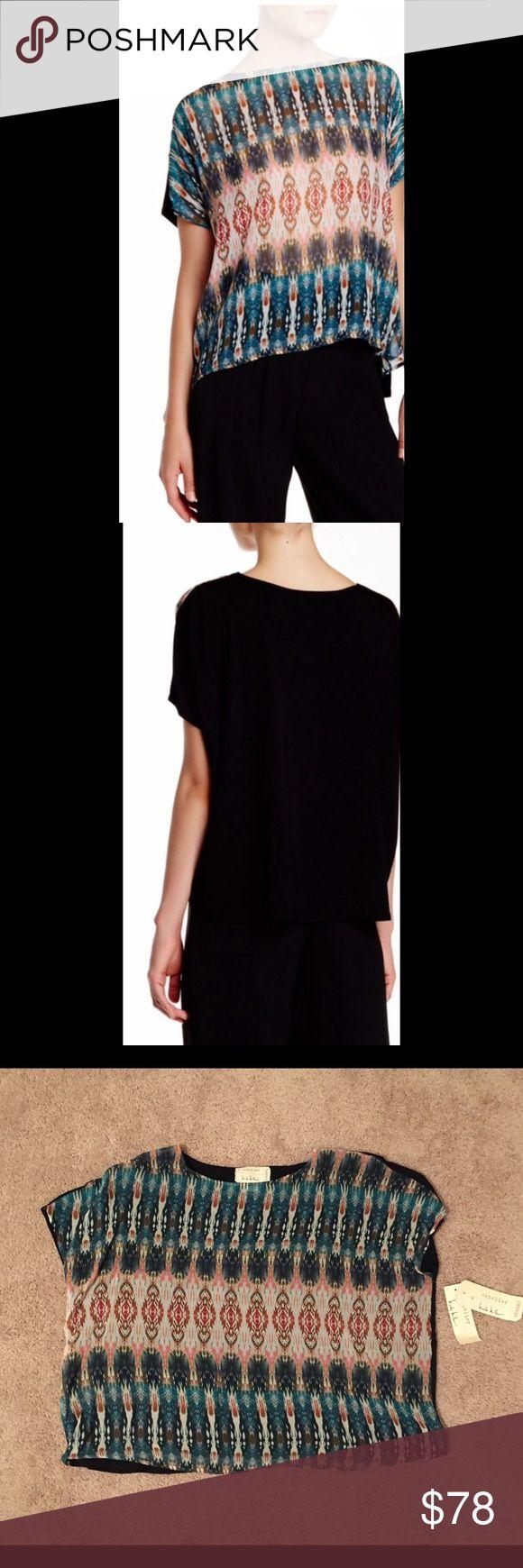 Nicole Miller Printed Blouse Scoop neck, short dolman sleeves, printed front with solid contrast back, hi-lo hem. Self: 100% viscose. Combo: 95% viscose, 5% spandex. Dry clean. Nicole Miller Tops