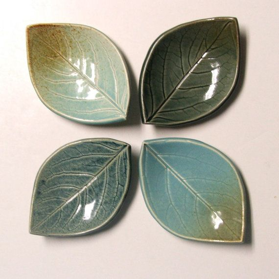 Two Pretty persimmon Leaf Plates. I accomplished this by pressing a live persimmon leaf into a slab of clay and then trimming and forming it to the final shape. The plates measure approximately 4 1/2 x 3. They were glazed and high fired to cone six (2232F). International shoppers please convo me for shipping cost to your location.