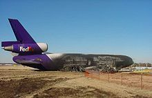 FedEx EXPRESS McDonnel Douglas MD-10-10 FLIGHT 647 VEERS OFF THE RUNWAY UPON LANDING AFTER LANDING GEAR COLLAPSE AND CATCHES FIRE AT MEMPHIS INTERNATIONAL AIRPORT IN 2003.