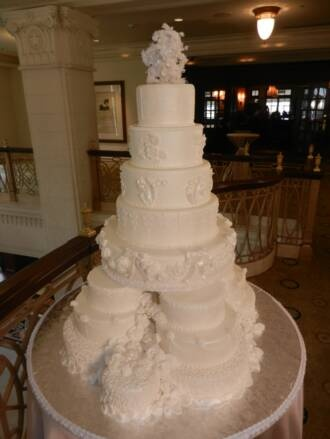 royal wedding cake, styrofoam cake, fondant wedding cake, traditional wedding cake, white fondant cake, edible flowers, edible roses, satellite cakes, SFA Intercontenintal Hotel Austin, tall wedding cake, round tier wedding cake, all white cake, cake with bows, edible lace cake