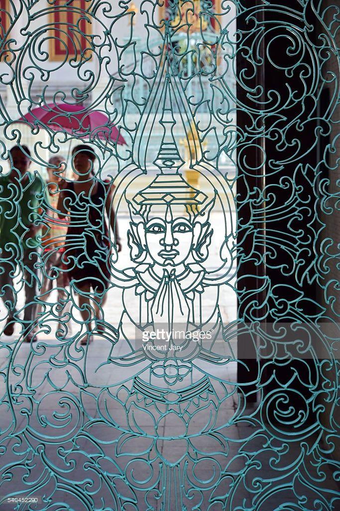 Metal gate Buddha representing at Royal Palace , Phnom Penh,...