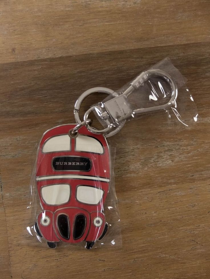 It's crafted from silver-tone brass, and finished with red, white and black enamel to resemble a double-decker bus.   eBay!
