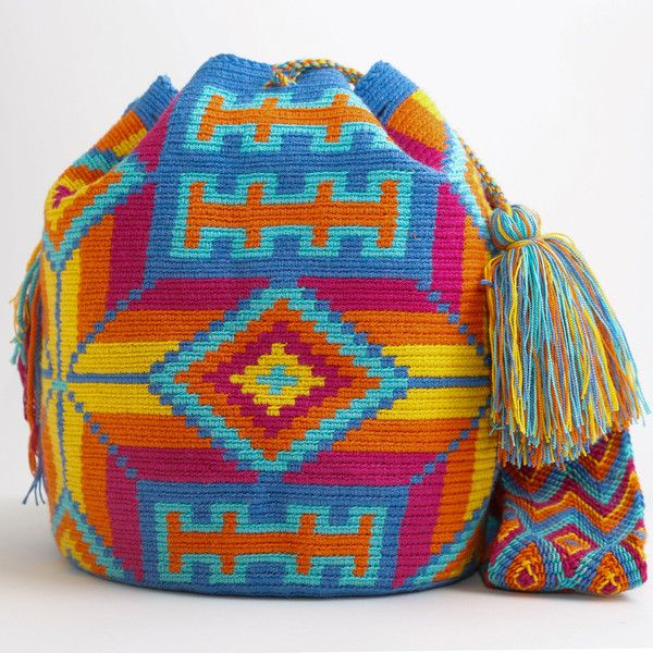 WAYUU TRIBE | #Handmade Bohemian Bags made by the indigenous Wayuu Tribe in Colombia!  #Bags starting at $98.00 - $225.00 We offer international shipping including Brazil.  #Mochila #Bolsa #Yoga #Crochet #Knit #yarn #moda #mode #boho #handbag #streetstyle #bucketbag