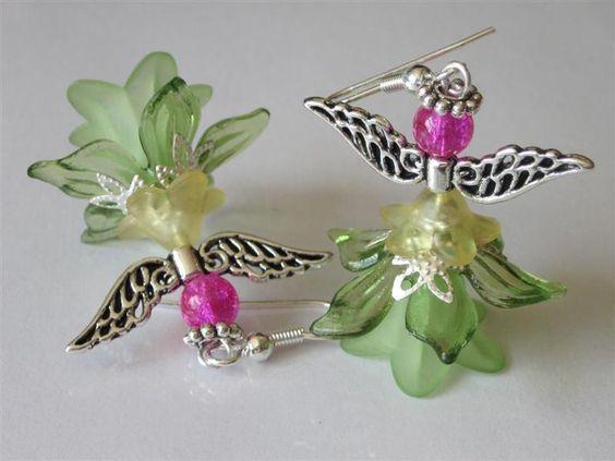 Garden Fairy Dangle Earrings Elegant Angel Beaded Green Sprite Lucite Flower Earrings Fantasy Spring Trends. $23.00, via Etsy.