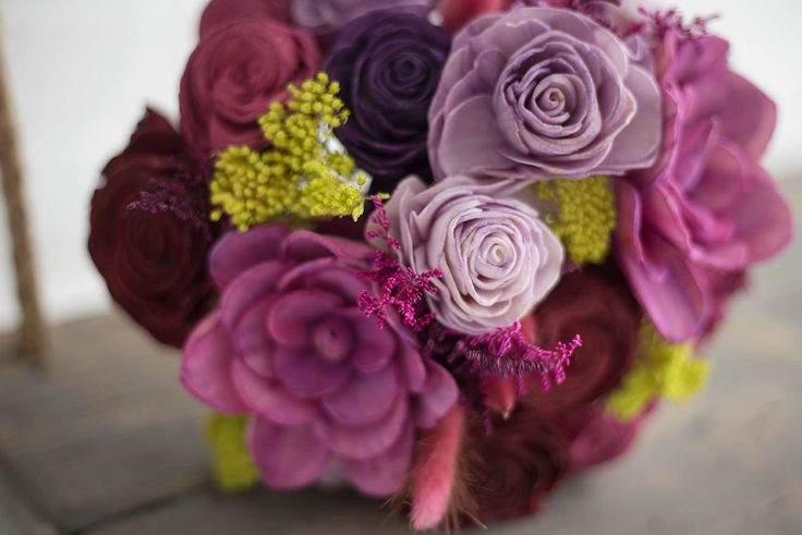 You won't even need to board a plane before you'll feel whisked away to lush locales with this Pretty Much Paradise bouquet. Purple and green accents, filled with 24 forever flowers of this tropical bouquet, while it's full peony styled flowers reflect the same warmth it's fun look makes you feel inside.