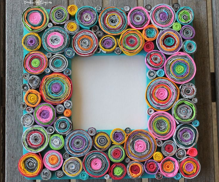 "Upcycled Rolled Paper Frame!This frame is visually stunning with lots of texture and pops of color!However...it's menace runs deeper.It was the most tedious and time consuming project I've ever wrangled my kids into doing.It all started like this. I had been planning this craft for a while...and my husband was out of town,so it seemed like a good time to catch up on projects.My nearly 12 year old son said ""hey mom, can I play Diablo?""and I said ""Yes, but hel..."