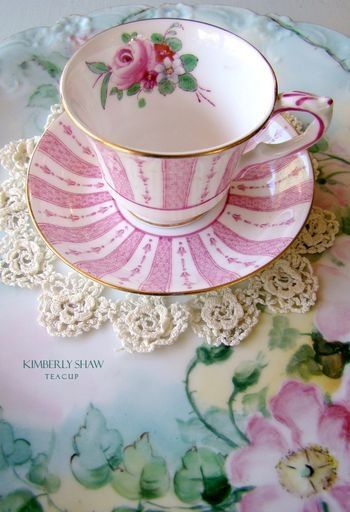 Such a pretty pink and white teacup and saucer.  I especially like the gilded rim and the flower inside.