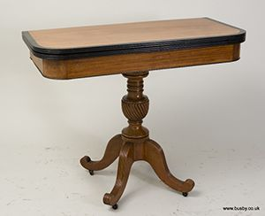 A late 19th century satinwood fold over card table.