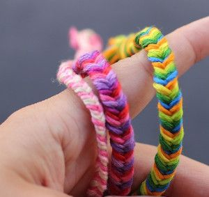 """These Effortless Fishtail Friendship Bracelets are the perfect summer crafts for children. Fishtail bracelets have been one of the hottest DIY bracelets for awhile but never seem to get old. Since they are """"hot"""" again this summer, why not make them into the always popular idea of a friendship bracelet?"""