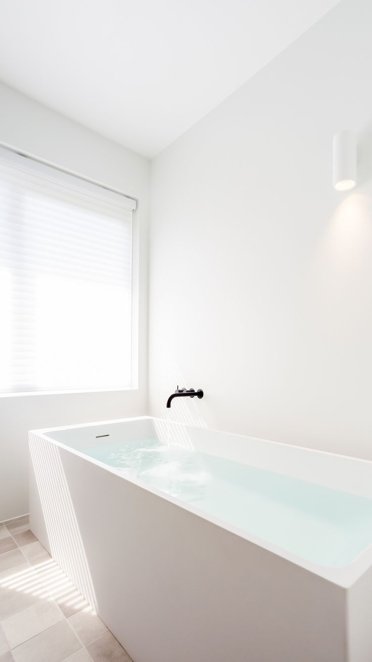 Studiodoccia drew the design for all the interior components of this residence in Zwolle. This bathroom reflects the total design with its simplicity and serenity, leaving space for balancing accents. Solid surface is used throughout the room, as seen in the Base washbasin and Axis bath by Not Only White. #notonlywhite