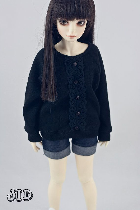 JID size Black sweater with lace front   I think she'll be able to squeeze into this.