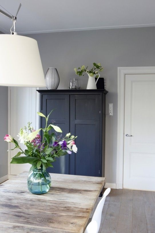 ?light grey walls and dark grey cupboard