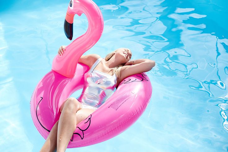 Charlotte Azou by Charlaine Croguennec fashion photographer - swimming pool - piscine - shooting - photoshoot - swimwear - maillot de bain - swimsuit - argenté - silver - beauty - beauté - pink - colorful - color - blue - sun - natural light - sunny day - editorial - flamingo - tube - flamant rose - mode - blond hair - blonde - cheveux - natural make up