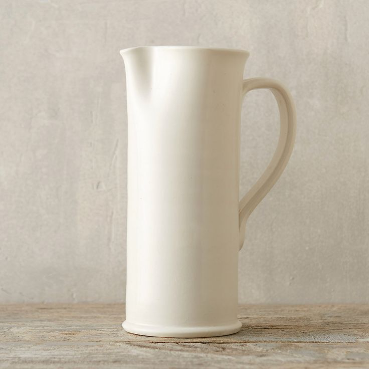 "First popularized in eighteenth-century England, creamware has long been a pretty and practical staple for serving and dining. We worked with a small Italian manufacturer to update classic, creamware serving shapes with a modern matte glaze. This elegant pitcher makes a perfectly understated addition to the table during holiday gatherings.- Ceramic- Hand wash- Italy10""H, 5"" diameter"