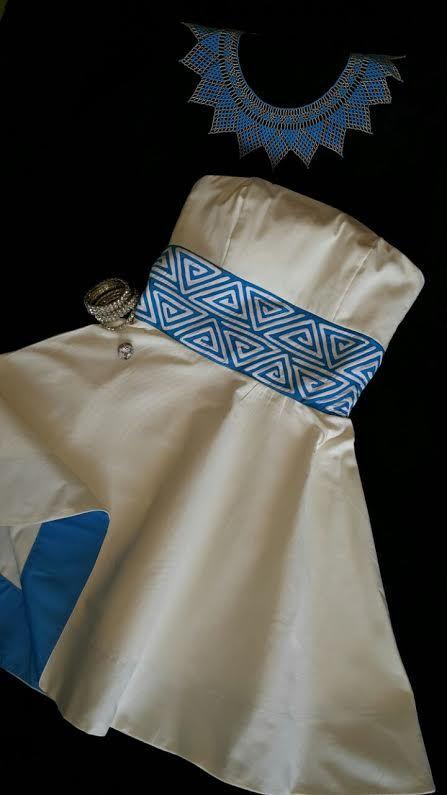 Vestido strapples con detalle de mola bordada en la cintura.  Siguenos en instagram guairabyjt