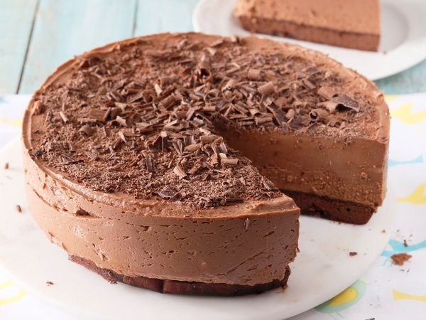 A deliciously creamy cake that's perfect for impressing guests. Chocolate mousse cake • Drizzle a little brandy over the cake base to add richness to the taste if you like.