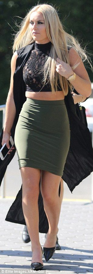 Glamorous:The alpine skier showed off her sculpted physique and toned legs in a curve hugging olive skirt
