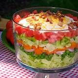 7 layer salad: bacon, tomatoes, cheese, lettuce, onions, eggs, celery, miracle whip + sugar and vinegar https://images.search.yahoo.com/images/view