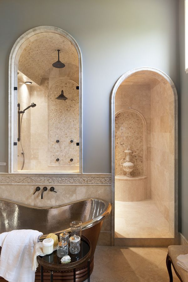 this is a shower worthy of a castle creamy stone graceful arches and a vaulted ceiling all create ambiance fit for royalty traditional bathroom by